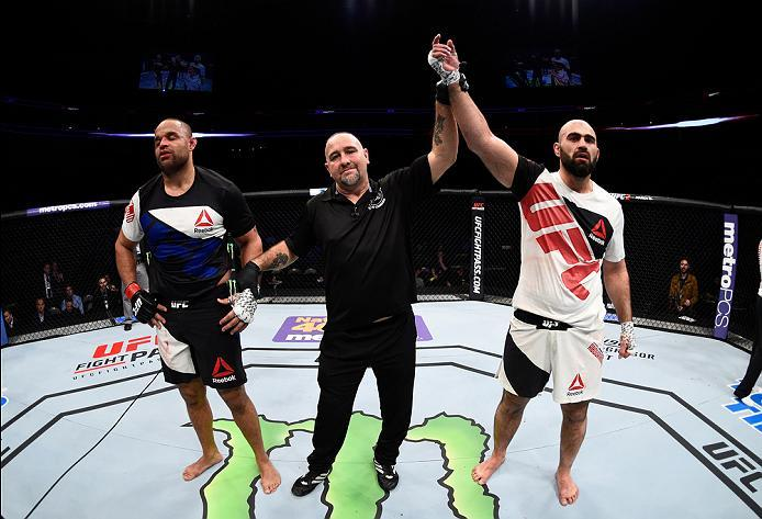 PITTSBURGH, PA - FEBRUARY 21:  (R-L) Shamil Abdurakhimov celebrates his win over Anthony Hamilton in their heavyweight bout during the UFC Fight Night event at Consol Energy Center on February 21, 2016 in Pittsburgh, Pennsylvania. (Photo by Jeff Bottari/Z