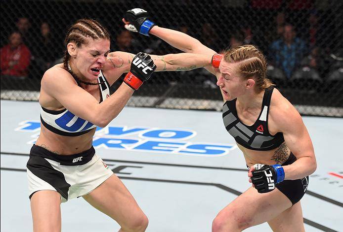 PITTSBURGH, PA - FEBRUARY 21:  (L-R) Lauren Murphy punches Kelly Faszholz in their women's bantamweight bout during the UFC Fight Night event at Consol Energy Center on February 21, 2016 in Pittsburgh, Pennsylvania. (Photo by Jeff Bottari/Zuffa LLC/Zuffa