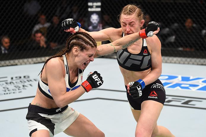 PITTSBURGH, PA - FEBRUARY 21:  (L-R) Lauren Murphy exchanges punches with Kelly Faszholz in their women's bantamweight bout during the UFC Fight Night event at Consol Energy Center on February 21, 2016 in Pittsburgh, Pennsylvania. (Photo by Jeff Bottari/Z
