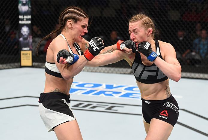 PITTSBURGH, PA - FEBRUARY 21:  (R-L) Kelly Faszholz exchanges punches with Lauren Murphy in their women's bantamweight bout during the UFC Fight Night event at Consol Energy Center on February 21, 2016 in Pittsburgh, Pennsylvania. (Photo by Jeff Bottari/Z