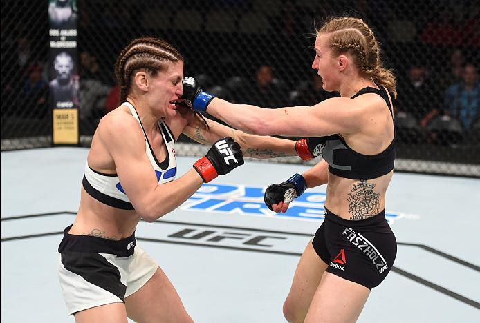 PITTSBURGH, PA - FEBRUARY 21:  (R-L) Kelly Faszholz punches Lauren Murphy in their women's bantamweight bout during the UFC Fight Night event at Consol Energy Center on February 21, 2016 in Pittsburgh, Pennsylvania. (Photo by Jeff Bottari/Zuffa LLC/Zuffa