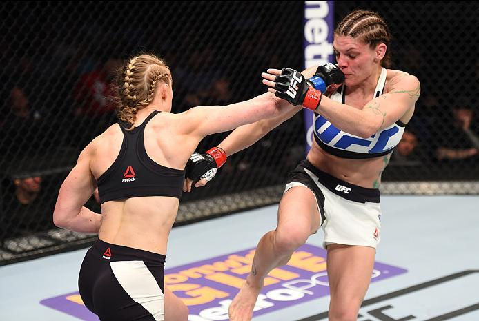 PITTSBURGH, PA - FEBRUARY 21:  (L-R) Kelly Faszholz punches Lauren Murphy in their women's bantamweight bout during the UFC Fight Night event at Consol Energy Center on February 21, 2016 in Pittsburgh, Pennsylvania. (Photo by Jeff Bottari/Zuffa LLC/Zuffa