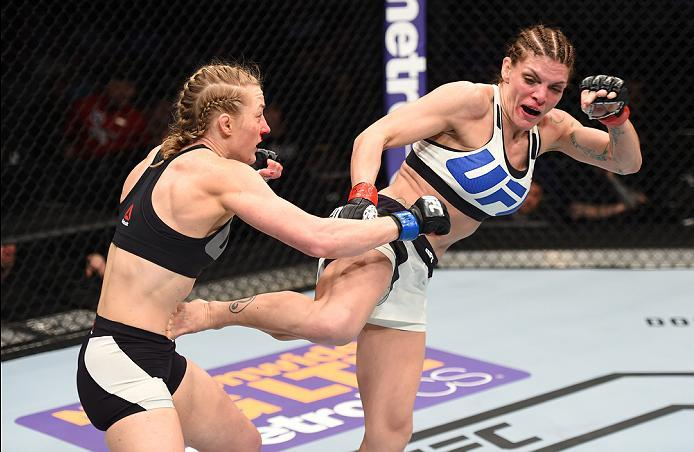 PITTSBURGH, PA - FEBRUARY 21:  (R-L) Lauren Murphy kicks Kelly Faszholz in their women's bantamweight bout during the UFC Fight Night event at Consol Energy Center on February 21, 2016 in Pittsburgh, Pennsylvania. (Photo by Jeff Bottari/Zuffa LLC/Zuffa LL