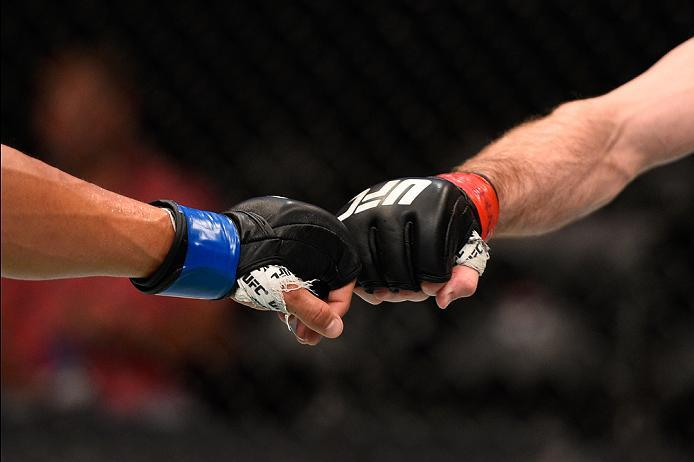 OTTAWA, ON - JUNE 18:   (L-R) Geane Herrera and Ali Bagautinov touch gloves in their flyweight bout during the UFC Fight Night event inside the TD Place Arena on June 18, 2016 in Ottawa, Ontario, Canada. (Photo by Jeff Bottari/Zuffa LLC/Zuffa LLC via Gett