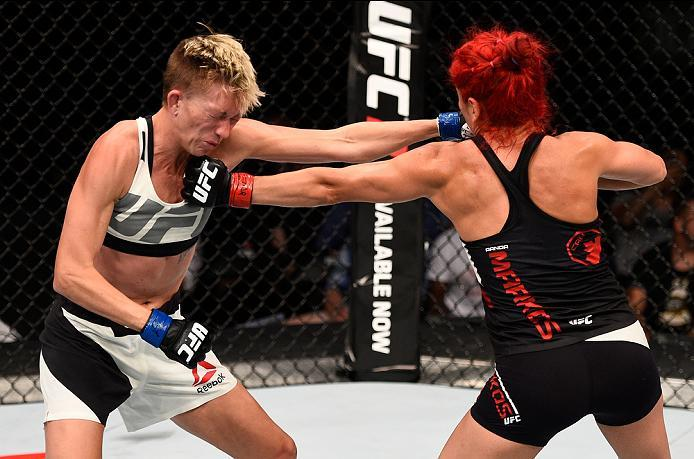 OTTAWA, ON - JUNE 18:   (R-L) Randa Markos of Iraq punches Jocelyn Jones-Lybarger of the United States in their women's strawweight bout during the UFC Fight Night event inside the TD Place Arena on June 18, 2016 in Ottawa, Ontario, Canada. (Photo by Jeff