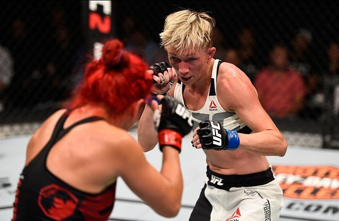 OTTAWA, ON - JUNE 18:   (R-L) Jocelyn Jones-Lybarger of the United States circles Randa Markos of Iraq in their women's strawweight bout during the UFC Fight Night event inside the TD Place Arena on June 18, 2016 in Ottawa, Ontario, Canada. (Photo by Jeff