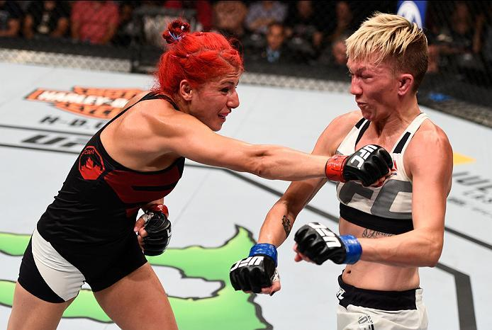 OTTAWA, ON - JUNE 18:   (L-R) Randa Markos of Iraq punches Jocelyn Jones-Lybarger of the United States in their women's strawweight bout during the UFC Fight Night event inside the TD Place Arena on June 18, 2016 in Ottawa, Ontario, Canada. (Photo by Jeff