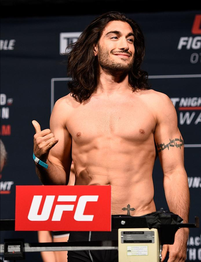 OTTAWA, ON - JUNE 17:  Elias Theodorou of Canada steps on the scale during the UFC Fight Night Weigh-in inside the Arena at TD Place on June 17, 2016 in Ottawa, Ontario, Canada. (Photo by Jeff Bottari/Zuffa LLC/Zuffa LLC via Getty Images)