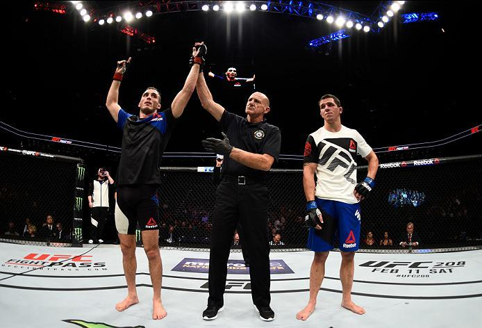 PHOENIX, AZ - JANUARY 15:  (L-R) Tony Martin celebrates his victory over Alex White in their lightweight bout during the UFC Fight Night event inside Talking Stick Resort Arena on January 15, 2017 in Phoenix, Arizona. (Photo by Jeff Bottari/Zuffa LLC/Zuff
