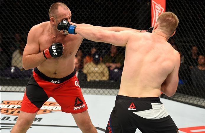 PHOENIX, AZ - JANUARY 15:  (L-R) Aleksei Oleinik of Russia exchanges punches with Viktor Pesta of Czech Republic in their heavyweight bout during the UFC Fight Night event inside Talking Stick Resort Arena on January 15, 2017 in Phoenix, Arizona. (Photo b