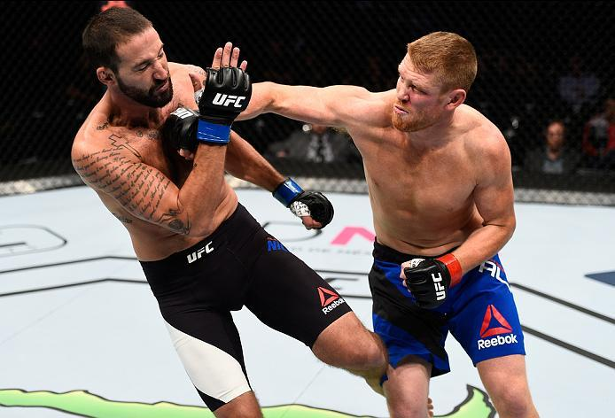 MEXICO CITY, MEXICO - NOVEMBER 05:  (R-L) Sam Alvey of the United States punches Alex Nicholson of the United States in their middleweight bout during the UFC Fight Night event at Arena Ciudad de Mexico on November 5, 2016 in Mexico City, Mexico. (Photo b