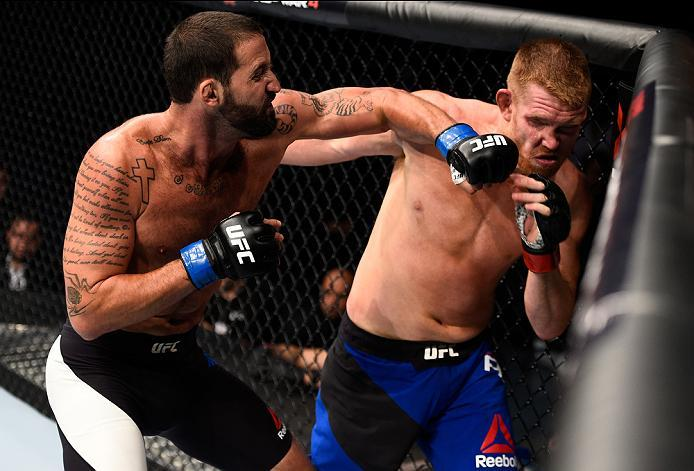 MEXICO CITY, MEXICO - NOVEMBER 05:  (L-R) Alex Nicholson of the United States punches Sam Alvey of the United States in their middleweight bout during the UFC Fight Night event at Arena Ciudad de Mexico on November 5, 2016 in Mexico City, Mexico. (Photo b