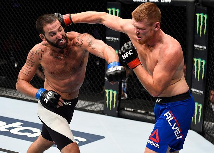 MEXICO CITY, MEXICO - NOVEMBER 05:  (L-R) Alex Nicholson of the United States exchanges punches with Sam Alvey of the United States in their middleweight bout during the UFC Fight Night event at Arena Ciudad de Mexico on November 5, 2016 in Mexico City, M