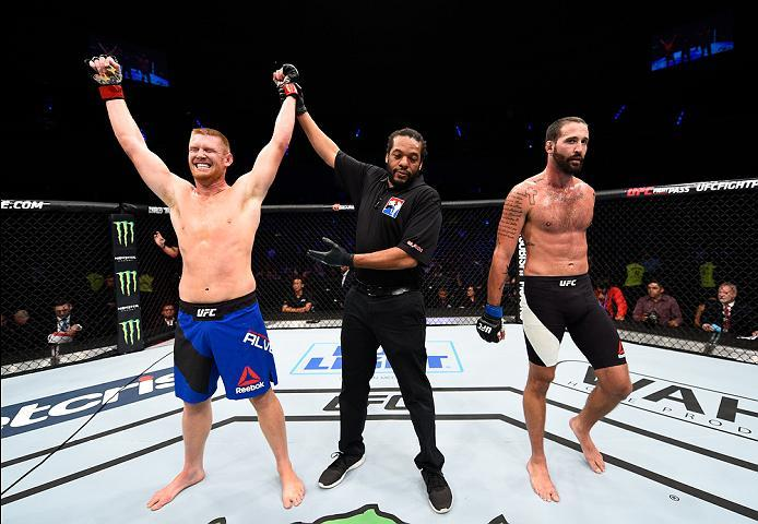 MEXICO CITY, MEXICO - NOVEMBER 05:  (L-R) Sam Alvey of the United States celebrates his victory over Alex Nicholson of the United States in their middleweight bout during the UFC Fight Night event at Arena Ciudad de Mexico on November 5, 2016 in Mexico Ci