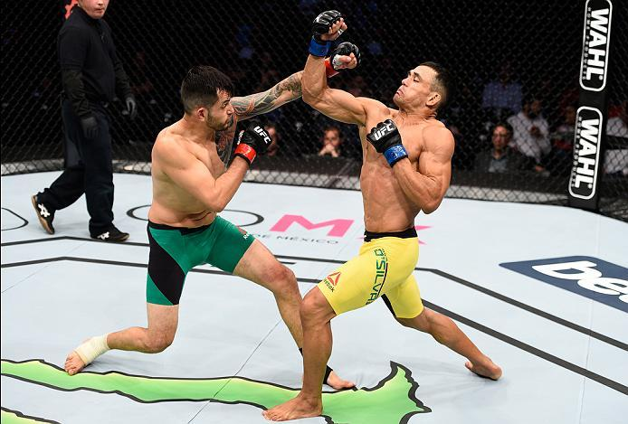 MEXICO CITY, MEXICO - NOVEMBER 05:  (R-L) Douglas Silva de Andrade of Brazil exchanges punches with Henry Briones of Mexico in their bantamweight bout during the UFC Fight Night event at Arena Ciudad de Mexico on November 5, 2016 in Mexico City, Mexico. (