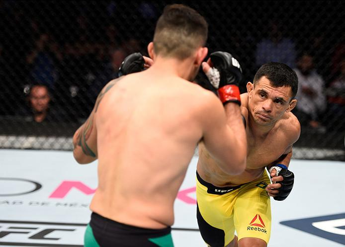MEXICO CITY, MEXICO - NOVEMBER 05:  (R-L) Douglas Silva de Andrade of Brazil punches Henry Briones of Mexico in their bantamweight bout during the UFC Fight Night event at Arena Ciudad de Mexico on November 5, 2016 in Mexico City, Mexico. (Photo by Jeff B