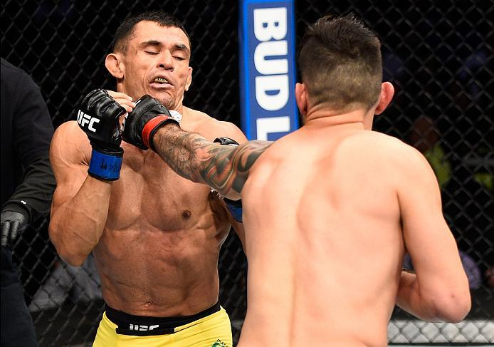 MEXICO CITY, MEXICO - NOVEMBER 05:  (R-L) Henry Briones of Mexico punches Douglas Silva de Andrade of Brazil in their bantamweight bout during the UFC Fight Night event at Arena Ciudad de Mexico on November 5, 2016 in Mexico City, Mexico. (Photo by Jeff B
