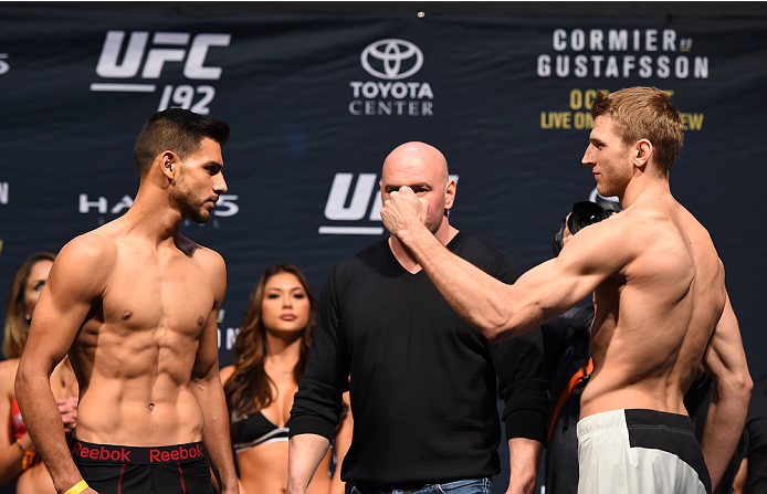 HOUSTON, TX - OCTOBER 02:  (L-R) Yair Rodriguez and Daniel Hooker face off during the UFC 192 weigh-in at the Toyota Center on October 2, 2015 in Houston, Texas. (Photo by Josh Hedges/Zuffa LLC/Zuffa LLC via Getty Images)