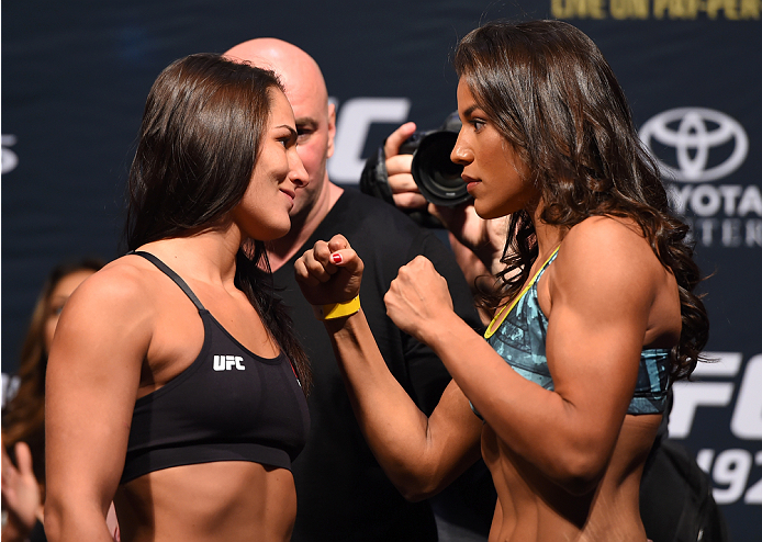 HOUSTON, TX - OCTOBER 02:  (L-R) Jessica Eye and Julianna Pena face off during the UFC 192 weigh-in at the Toyota Center on October 2, 2015 in Houston, Texas. (Photo by Josh Hedges/Zuffa LLC/Zuffa LLC via Getty Images)
