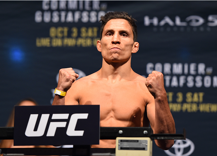 HOUSTON, TX - OCTOBER 02:  Joseph Benavidez steps on the scale during the UFC 192 weigh-in at the Toyota Center on October 2, 2015 in Houston, Texas. (Photo by Josh Hedges/Zuffa LLC/Zuffa LLC via Getty Images)