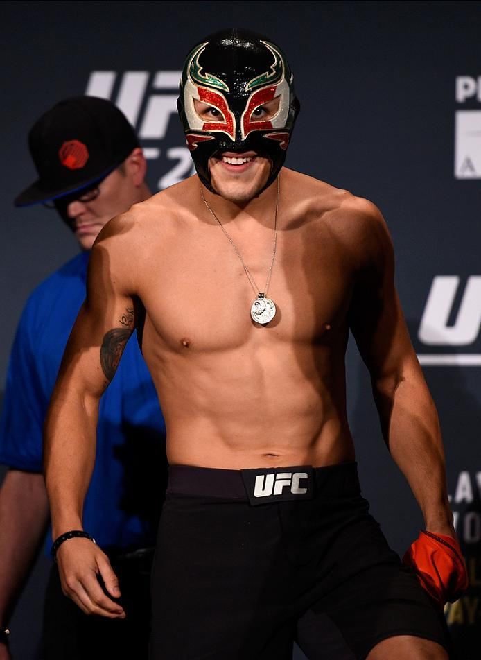 ATLANTA, GA - JULY 29:  Erik Perez of Mexico prepares to step on the scale during the UFC 201 weigh-in at Fox Theatre on July 29, 2016 in Atlanta, Georgia. (Photo by Jeff Bottari/Zuffa LLC/Zuffa LLC via Getty Images)