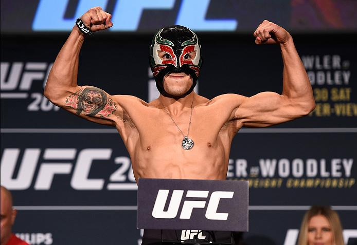 ATLANTA, GA - JULY 29:  Erik Perez of Mexico steps on the scale during the UFC 201 weigh-in at Fox Theatre on July 29, 2016 in Atlanta, Georgia. (Photo by Jeff Bottari/Zuffa LLC/Zuffa LLC via Getty Images)