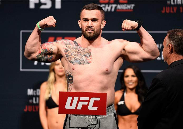 SIOUX FALLS, SD - JULY 12:   Daniel Omielanczuk steps onto the scale during the UFC Fight Night weigh-in at Denny Sanford Premier Center on July 12, 2016 in Sioux Falls, South Dakota. (Photo by Jeff Bottari/Zuffa LLC/Zuffa LLC via Getty Images)