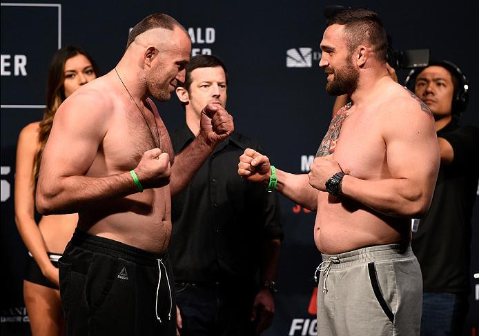 SIOUX FALLS, SD - JULY 12:   (L-R) Aleksei Oleinik and Daniel Omielanczuk face off during the UFC Fight Night weigh-in at Denny Sanford Premier Center on July 12, 2016 in Sioux Falls, South Dakota. (Photo by Jeff Bottari/Zuffa LLC/Zuffa LLC via Getty Imag