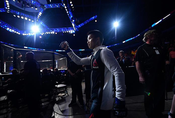 SIOUX FALLS, SD - JULY 13:   Ben Nguyen prepares to enter the Octagon before facing Louis Smolka in their flyweight bout during the UFC Fight Night event on July 13, 2016 at Denny Sanford Premier Center in Sioux Falls, South Dakota. (Photo by Jeff Bottari