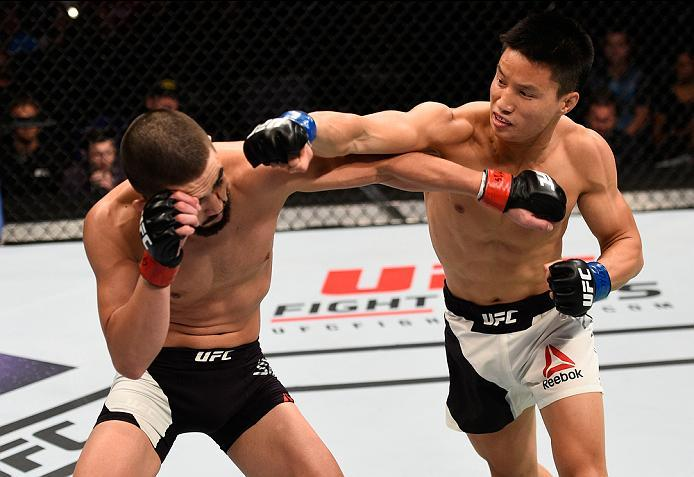 SIOUX FALLS, SD - JULY 13:   (R-L) Ben Nguyen punches Louis Smolka in their flyweight bout during the UFC Fight Night event on July 13, 2016 at Denny Sanford Premier Center in Sioux Falls, South Dakota. (Photo by Jeff Bottari/Zuffa LLC/Zuffa LLC via Getty