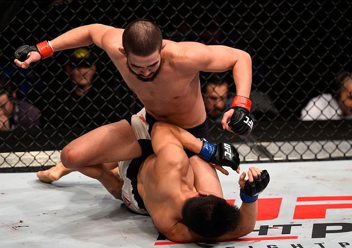 SIOUX FALLS, SD - JULY 13:   Louis Smolka (top) punches Ben Nguyen in their flyweight bout during the UFC Fight Night event on July 13, 2016 at Denny Sanford Premier Center in Sioux Falls, South Dakota. (Photo by Jeff Bottari/Zuffa LLC/Zuffa LLC via Getty