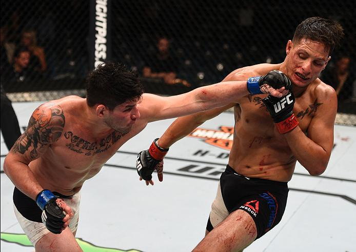 LAS VEGAS, NV - JULY 07:   (L-R) Dileno Lopes of Brazil punches Anthony Birchak in their bantamweight bout during the UFC Fight Night event inside the MGM Grand Garden Arena on July 7, 2016 in Las Vegas, Nevada. (Photo by Jeff Bottari/Zuffa LLC/Zuffa LLC