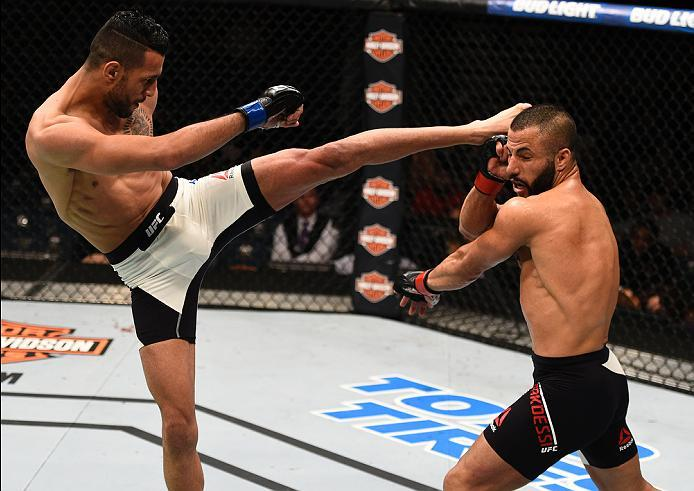 LAS VEGAS, NV - JULY 07:   (L-R) Mehdi Baghdad of France kicks John Makdessi of Canada in their lightweight bout during the UFC Fight Night event inside the MGM Grand Garden Arena on July 7, 2016 in Las Vegas, Nevada. (Photo by Jeff Bottari/Zuffa LLC/Zuff