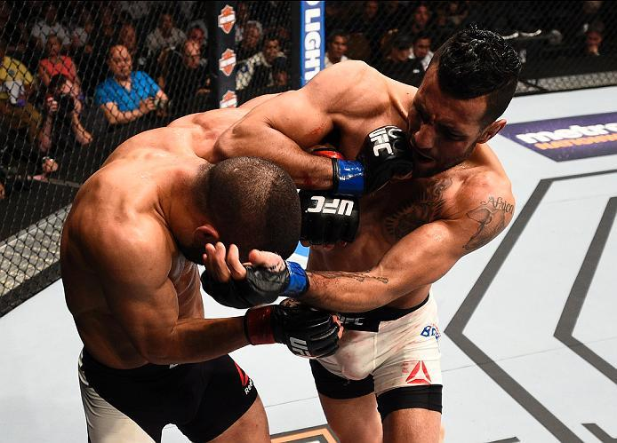 LAS VEGAS, NV - JULY 07:   (R-L) Mehdi Baghdad of France elbows John Makdessi of Canada in their lightweight bout during the UFC Fight Night event inside the MGM Grand Garden Arena on July 7, 2016 in Las Vegas, Nevada. (Photo by Jeff Bottari/Zuffa LLC/Zuf