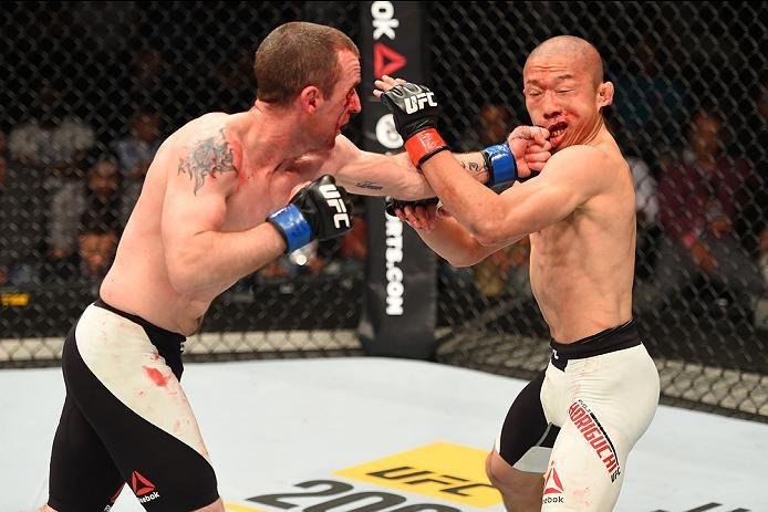 ROTTERDAM, NETHERLANDS - MAY 08:  (L-R) Neil Seery punches Kyoji Horiguchi in their flyweight bout during the UFC Fight Night event at Ahoy Rotterdam on May 8, 2016 in Rotterdam, Netherlands. (Photo by Josh Hedges/Zuffa LLC/Zuffa LLC via Getty Images)