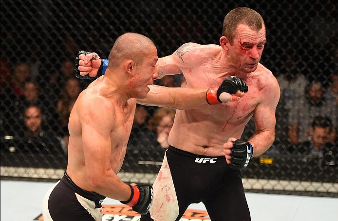 ROTTERDAM, NETHERLANDS - MAY 08:  (L-R) Kyoji Horiguchi punches Neil Seery in their flyweight bout during the UFC Fight Night event at Ahoy Rotterdam on May 8, 2016 in Rotterdam, Netherlands. (Photo by Josh Hedges/Zuffa LLC/Zuffa LLC via Getty Images)