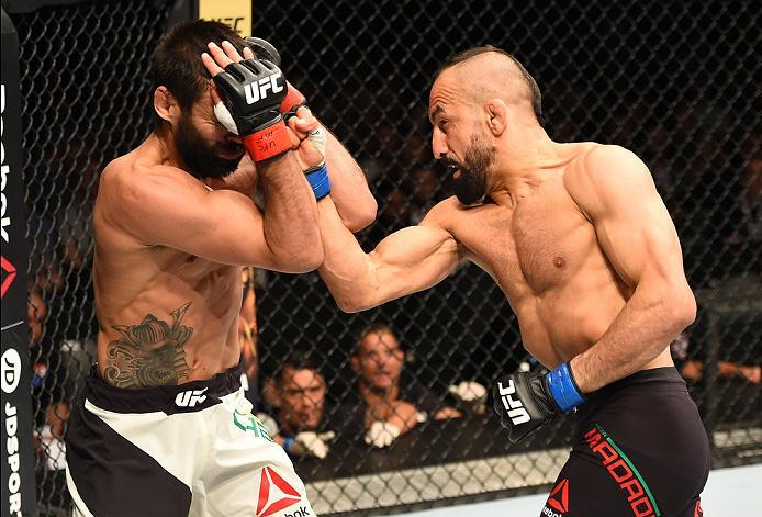 ROTTERDAM, NETHERLANDS - MAY 08:  (R-L) Reza Madadi punches Yan Cabral in their lightweight bout during the UFC Fight Night event at Ahoy Rotterdam on May 8, 2016 in Rotterdam, Netherlands. (Photo by Josh Hedges/Zuffa LLC/Zuffa LLC via Getty Images)