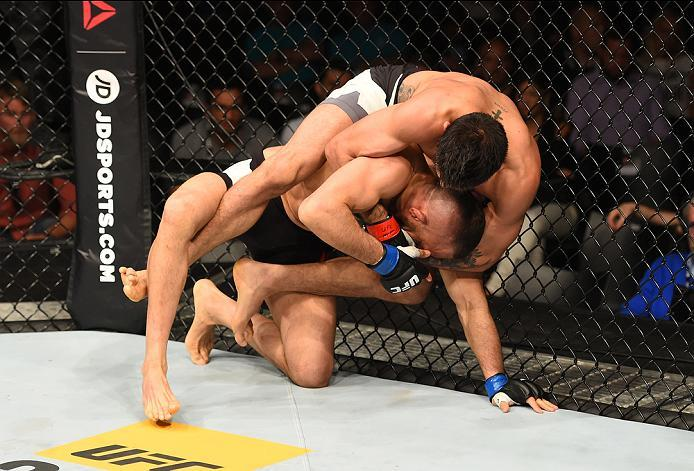 ROTTERDAM, NETHERLANDS - MAY 08:  Yan Cabral  (top) controls the body of Reza Madadi in their lightweight bout during the UFC Fight Night event at Ahoy Rotterdam on May 8, 2016 in Rotterdam, Netherlands. (Photo by Josh Hedges/Zuffa LLC/Zuffa LLC via Getty