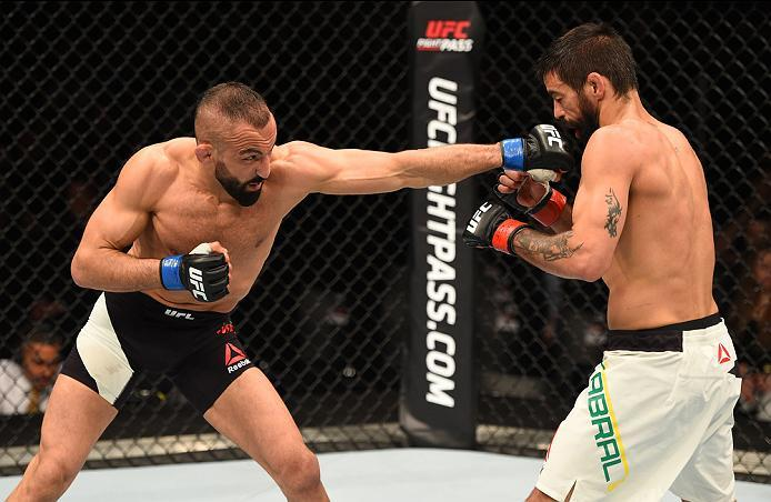 ROTTERDAM, NETHERLANDS - MAY 08:  (L-R) Reza Madadi punches Yan Cabral in their lightweight bout during the UFC Fight Night event at Ahoy Rotterdam on May 8, 2016 in Rotterdam, Netherlands. (Photo by Josh Hedges/Zuffa LLC/Zuffa LLC via Getty Images)