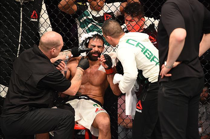 ROTTERDAM, NETHERLANDS - MAY 08:  Yan Cabral is checked by the cutman in between rounds while facing Reza Madadi in their lightweight bout during the UFC Fight Night event at Ahoy Rotterdam on May 8, 2016 in Rotterdam, Netherlands. (Photo by Josh Hedges/Z