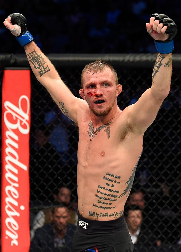 DALLAS, TX - MAY 13:  Jason Knight celebrates his TKO victory over Chas Skelly in their featherweight fight during the UFC 211 event at the American Airlines Center on May 13, 2017 in Dallas, Texas. (Photo by Josh Hedges/Zuffa LLC/Zuffa LLC via Getty Imag