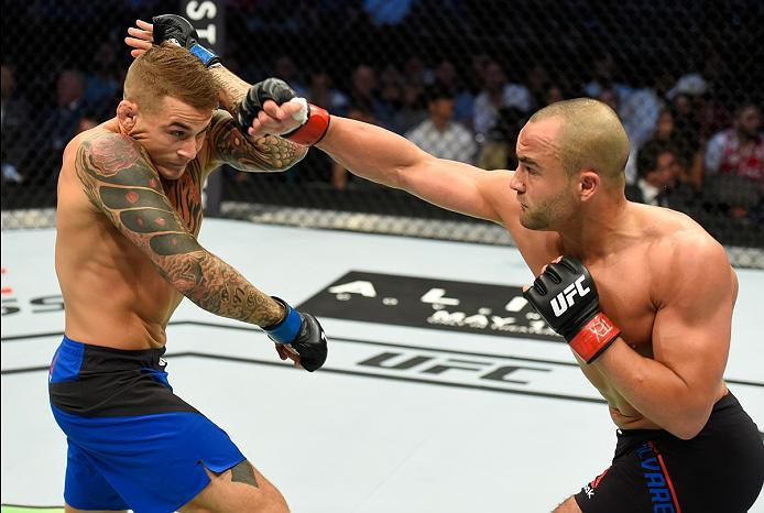 DALLAS, TX - MAY 13:  (R-L) Eddie Alvarez punches Dustin Poirier in their lightweight fight during the UFC 211 event at the American Airlines Center on May 13, 2017 in Dallas, Texas. (Photo by Josh Hedges/Zuffa LLC/Zuffa LLC via Getty Images)