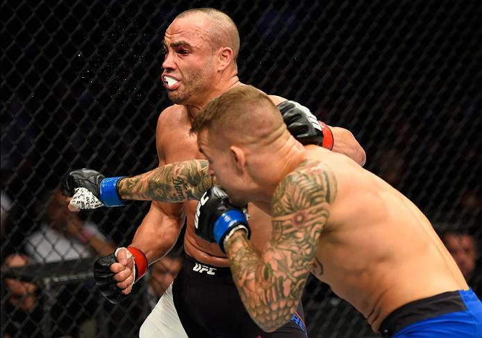 DALLAS, TX - MAY 13:  (R-L) Dustin Poirier punches Eddie Alvarez in their lightweight fight during the UFC 211 event at the American Airlines Center on May 13, 2017 in Dallas, Texas. (Photo by Josh Hedges/Zuffa LLC/Zuffa LLC via Getty Images)