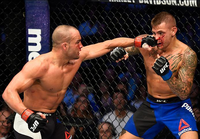 DALLAS, TX - MAY 13:  (L-R) Eddie Alvarez punches Dustin Poirier in their lightweight fight during the UFC 211 event at the American Airlines Center on May 13, 2017 in Dallas, Texas. (Photo by Josh Hedges/Zuffa LLC/Zuffa LLC via Getty Images)
