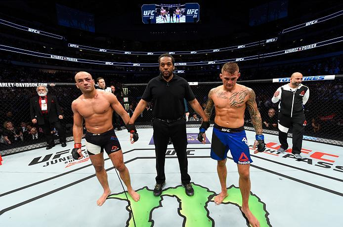 DALLAS, TX - MAY 13:  (R-L) Dustin Poirier and Eddie Alvarez reacts to the result of their lightweight fight being announced as a no contest after an illegal knee from Eddie Alvarez during the UFC 211 event at the American Airlines Center on May 13, 2017