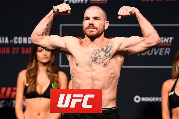 VANCOUVER, BC - AUGUST 26:  Jim Miller of the United States steps on the scale during the UFC Fight Night Weigh-in at Rogers Arena on August 26, 2016 in Vancouver, British Columbia, Canada. (Photo by Jeff Bottari/Zuffa LLC/Zuffa LLC via Getty Images)