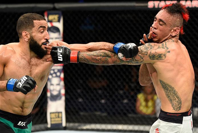 HIDALGO, TX - SEPTEMBER 17:   (L-R) Belal Muhammad  punches Augusto Montano of Mexico in their welterweight bout during the UFC Fight Night event at State Farm Arena on September 17, 2016 in Hidalgo, Texas. (Photo by Josh Hedges/Zuffa LLC/Zuffa LLC via Ge