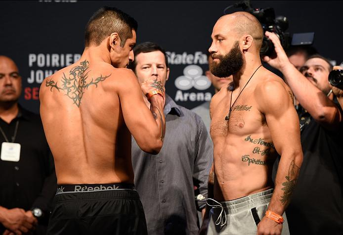 HIDALGO, TX - SEPTEMBER 16:  (L-R) Gabriel Benitez of Mexico and Sam Sicilia of the United States face off during the UFC Fight Night weigh-in at the State Farm Arena on September 16, 2016 in Hidalgo, Texas. (Photo by Josh Hedges/Zuffa LLC/Zuffa LLC via G