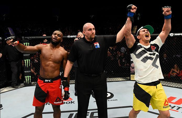 LONDON, ENGLAND - MARCH 18:  (R-L) Francimar Barroso of Brazil celebrates his victory over Darren Stewart of England in their light heavyweight fight during the UFC Fight Night event at The O2 arena on March 18, 2017 in London, England. (Photo by Josh Hed