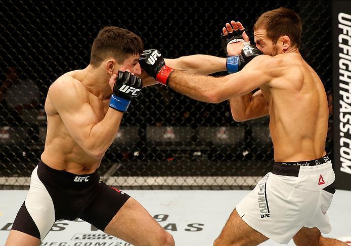 ZAGREB, CROATIA - APRIL 10:   (L-R) Damir Hadzovic punches Mairbek Taisumov in their lightweight bout during the UFC Fight Night event at the Arena Zagreb on April 10, 2016 in Zagreb, Croatia. (Photo by Srdjan Stevanovic/Zuffa LLC/Zuffa LLC via Getty Imag